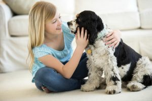 Girl playing with her pet dog